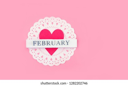 """heart and inscription """"February"""". beautiful Valentine day background. love heart, festive card. minimal creative holiday scene. love concept for valentines day, 14 February. copy space"""