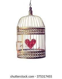 Heart inside the bird Cage. On white background. Love/romance concept.