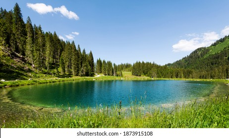Heart Lake in Kleinwalser Valley in Vorarlberg, Austria The Heart Lake is an artificial lake as a water reservoir for the snow cannons in the winter. In the summer it is a swimming lake.
