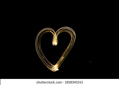 Heart Light Painting in Dark with Hand