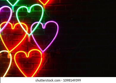 Heart light shape sparkle at night background.