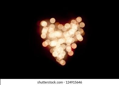 Heart of lights on black background