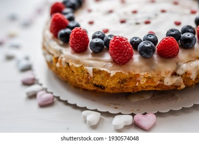 heart love carrot cake mothersday, valentines day, wedding cake with blueberries, raspberries, and heart sprinkles