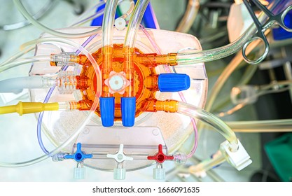 Heart lung machine oxygenator. Abstract image of medical plastic tubes and bubbles.