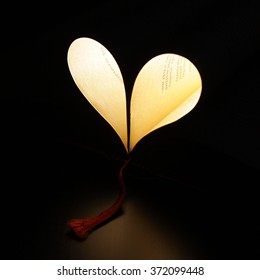 Heart made of book and light