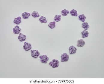 heart made by the candy , sweet love with candy color violet, give your sweet heart with candy color purple in Valentine's day is romantic