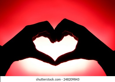 A heart made by hands to show the concept of love and emotion