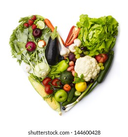 Heart made by various vegetables and fruits isolated on white.