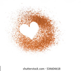 Heart made of cocoa powder on white background, free space, top view, love concept