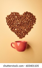 The heart is made with coffee beans with red mug