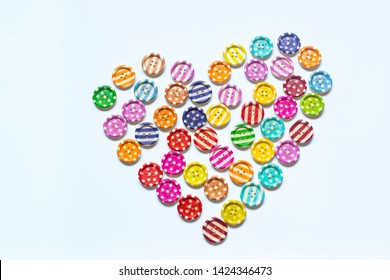 Heart made of colorful and beautiful sewing buttons isolated on white background