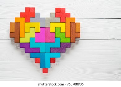 Heart made of colorful wooden shapes, top view, flat lay. Health background concept.