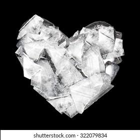 Heart made of crashed ice on black background.