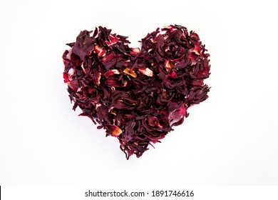heart made of dried roselle flower on white background, healthy life and nutrition concept