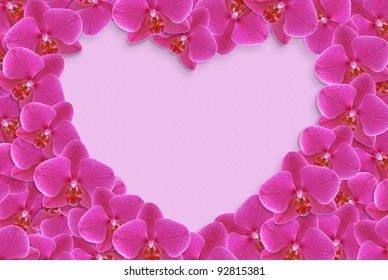 Heart made of flowers on lilac background