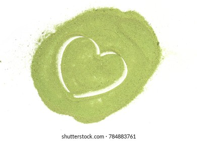 Heart made of green tea powder on white background, free space, top view, love concept