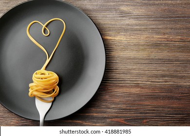 Heart made with pasta on the plate