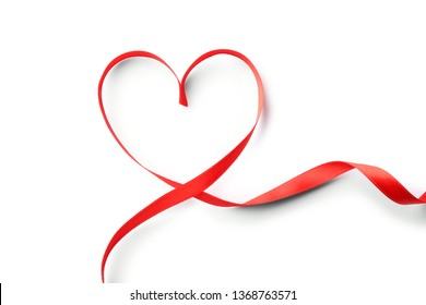 Heart made of red ribbon on white background, top view. Festive decoration