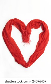 Heart made of a red scarf isolated on white
