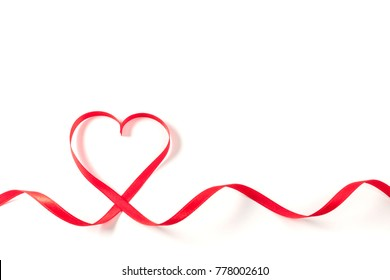 Heart made of ribbon on white background. Valentines day.