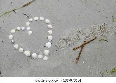 A heart made of shells on the beach, 'Baltic sea'