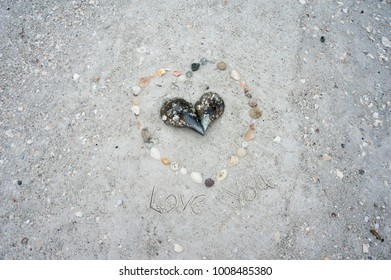 Heart made of shells on a sandy beach on the Gulf of Mexico at St. Pete Beach, Florida.