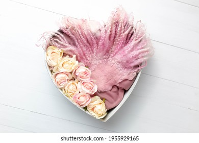 heart made of wood decorated with roses. basket for a photo shoot of newborns. pink rose. heart props for photographers. background for newborns. furniture for dolls