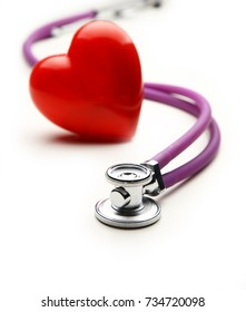 Heart with a medical stethoscope, isolated on wooden background