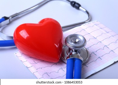 Heart with medical stethoscope on the paper cardiogram