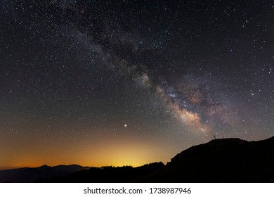 The Heart of Milky Way. View from Mountain with rood on the peak during the night time. Monte Livata. Italy