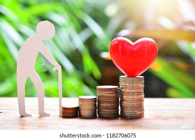 heart model set on money coins saving for concept insurance finance and  fund healthy
