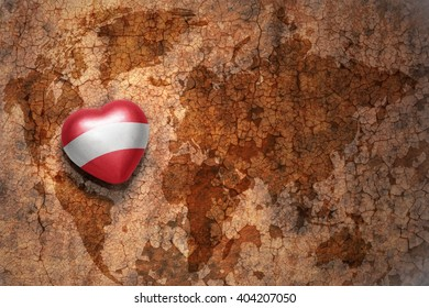 heart with national flag of austria on a vintage world map crack paper background. concept