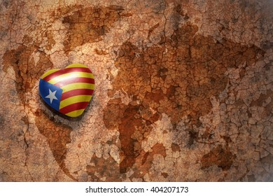heart with national flag of catalonia on a vintage world map crack paper background. concept