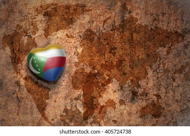 heart with national flag of comoros on a vintage world map crack paper background. concept