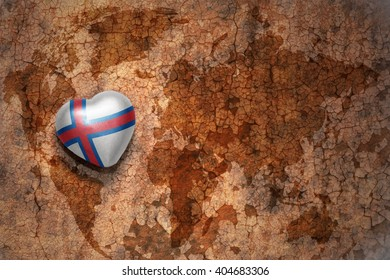 heart with national flag of faroe islands on a vintage world map crack paper background. concept