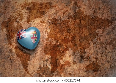 heart with national flag of Fiji on a vintage world map crack paper background. concept