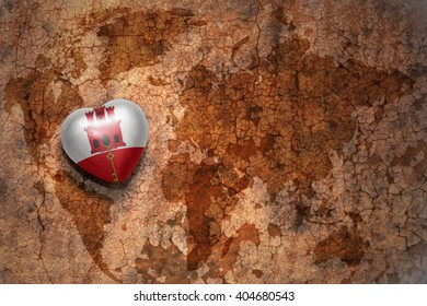 heart with national flag of gibraltar on a vintage world map crack paper background. concept