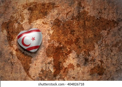 heart with national flag of northern cyprus on a vintage world map crack paper background. concept