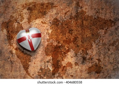 heart with national flag of northern ireland on a vintage world map crack paper background. concept