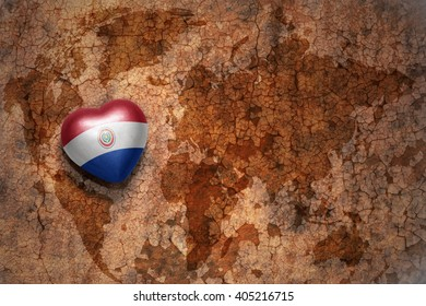 heart with national flag of paraguay on a vintage world map crack paper background. concept