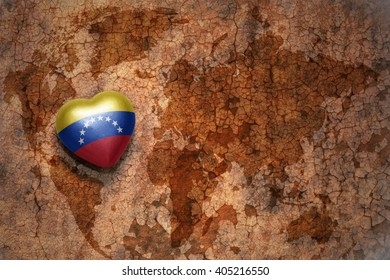 heart with national flag of venezuela on a vintage world map crack paper background. concept
