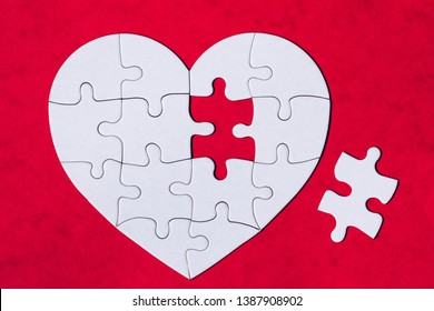 Heart object made of puzzle pieces. Make complete heart. Jigsaw puzzle pieces in form of heart. Happy Valentines Day, greeting card template. Heart jigsaw puzzle.