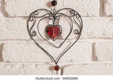 heart on concrete wall