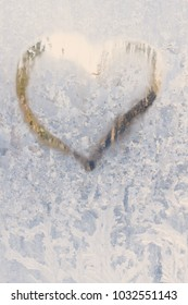 Heart on a frosty, icy window