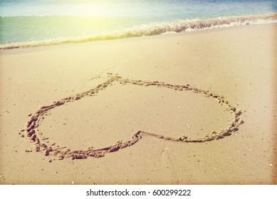 heart on sand. On the seacoast.Toned photo on retro style