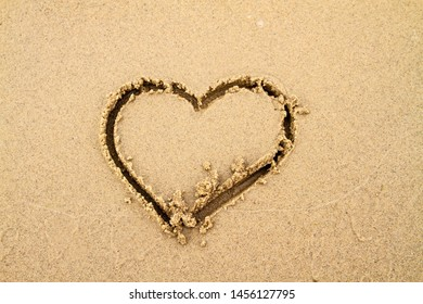 heart on the sand on the shore