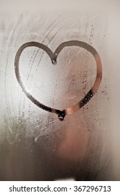 Heart on steamed up mirror in the bathroom.