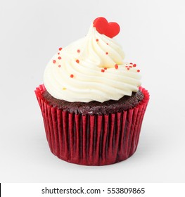 Heart on top of cupcake valentine on white background.