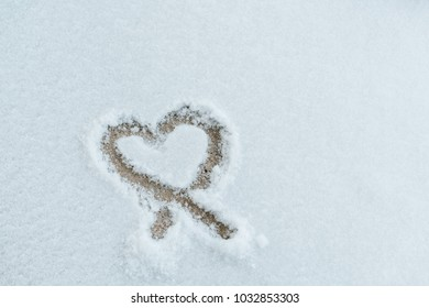 heart on a white snowy background