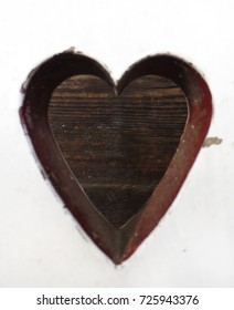 Heart on wooden chair